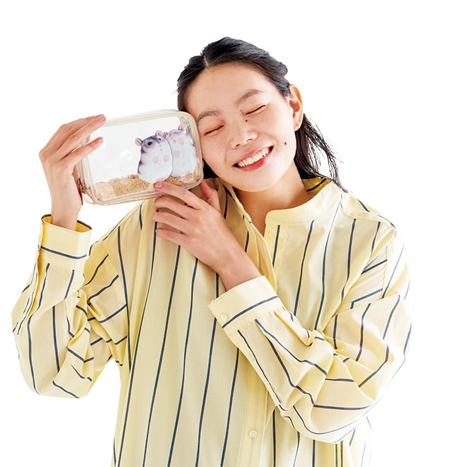 lady holding up hamster pouch