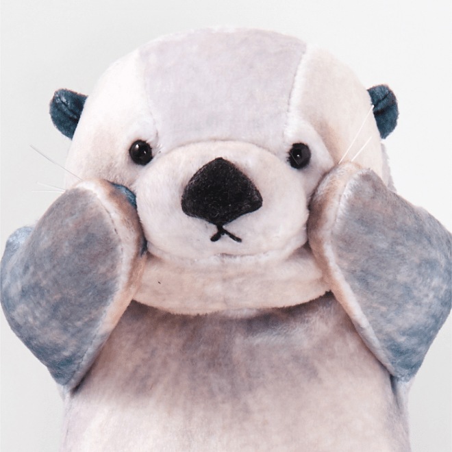 sea otter pouch - paw on cheek