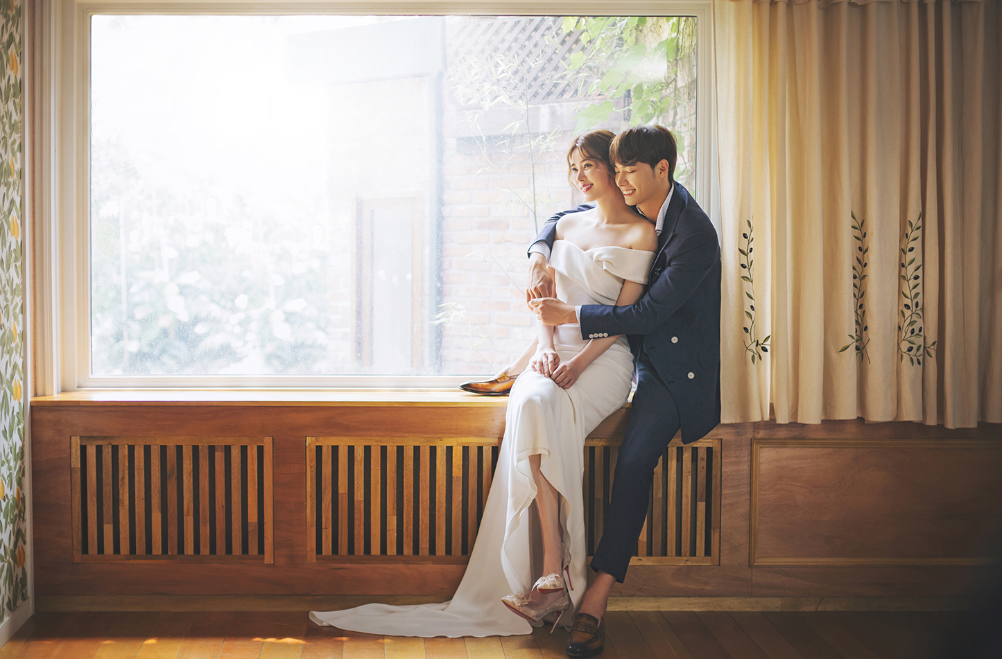 korean wedding photoshoot couple on a wooden window sill