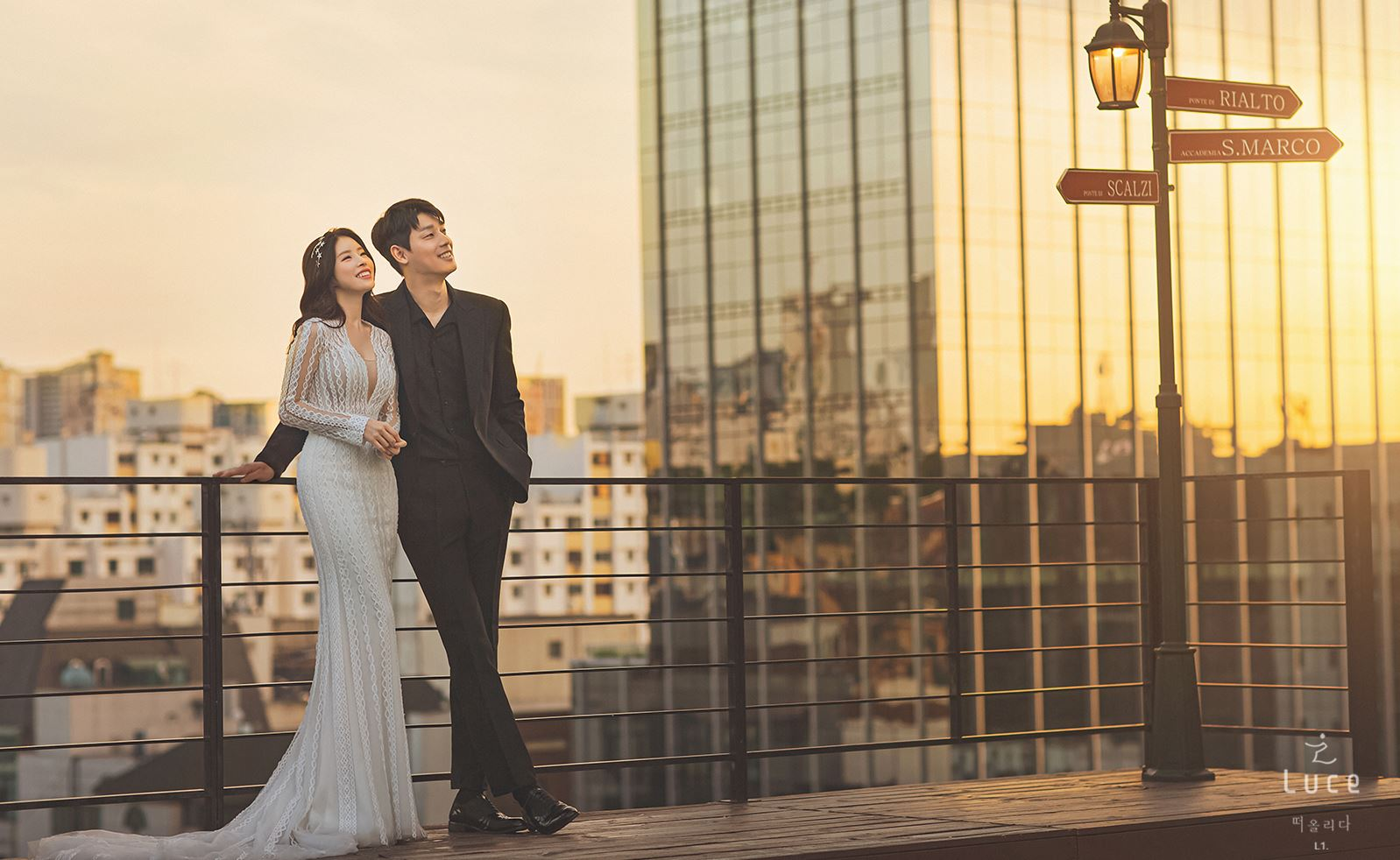 korean wedding photoshoot couple gazing at the sky