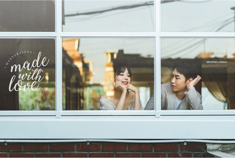 korean wedding photoshoot window shot of couple