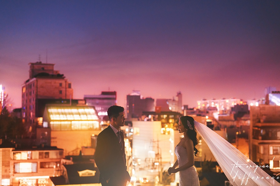 korean wedding photoshoot couple shot with a purple setting sun