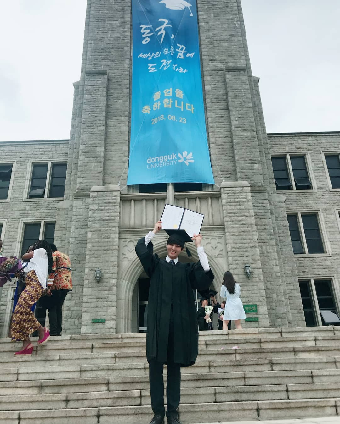 korean idol university majors - Young K on the day of his graduation