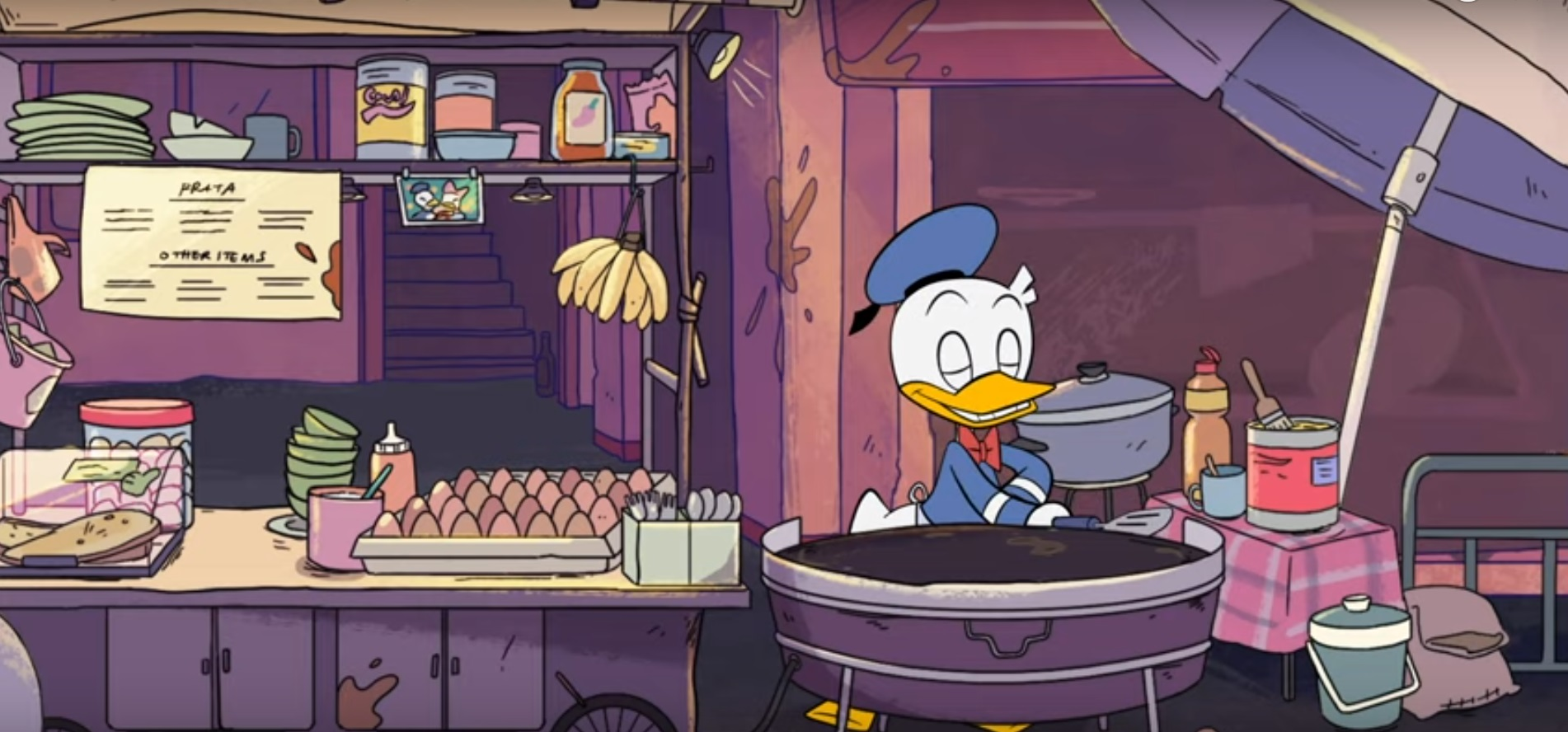 Donald Duck flipping roti canai