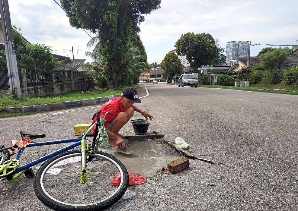 Panjang patches potholes in Johor