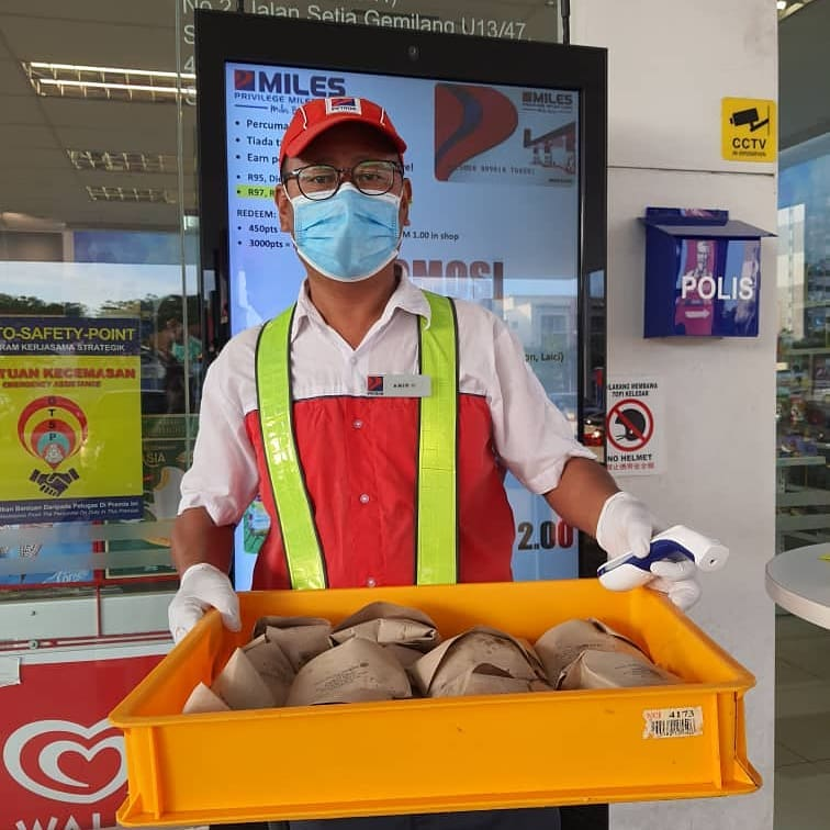 Petron hands out free food to customers during MCO