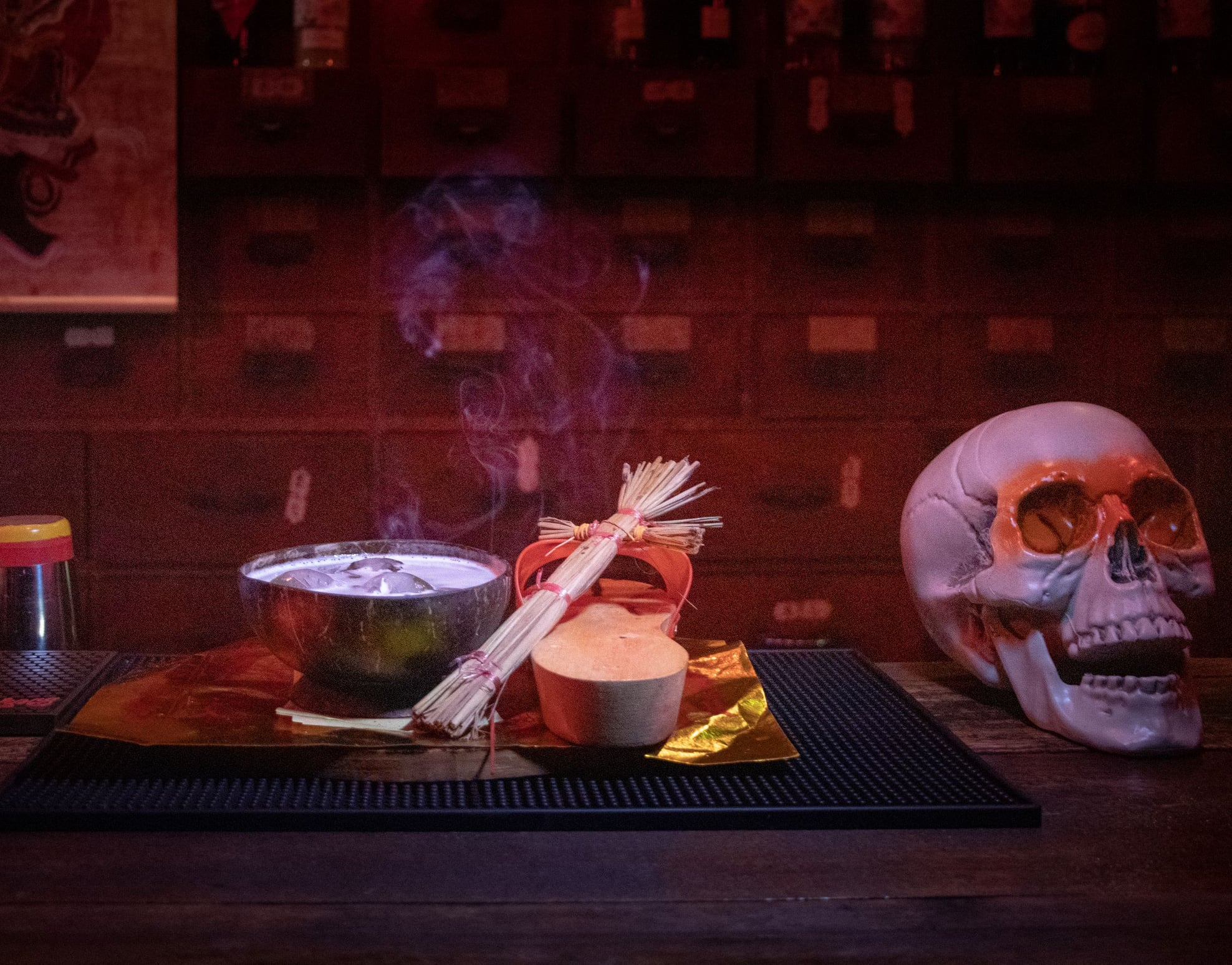 cocktail with skull and voodoo doll as props