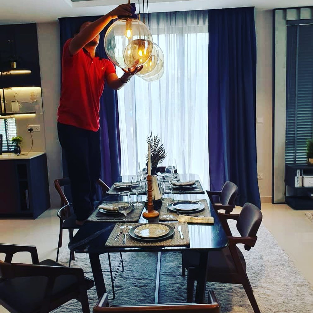 Ultra Cleaning - man cleaning ceiling lights