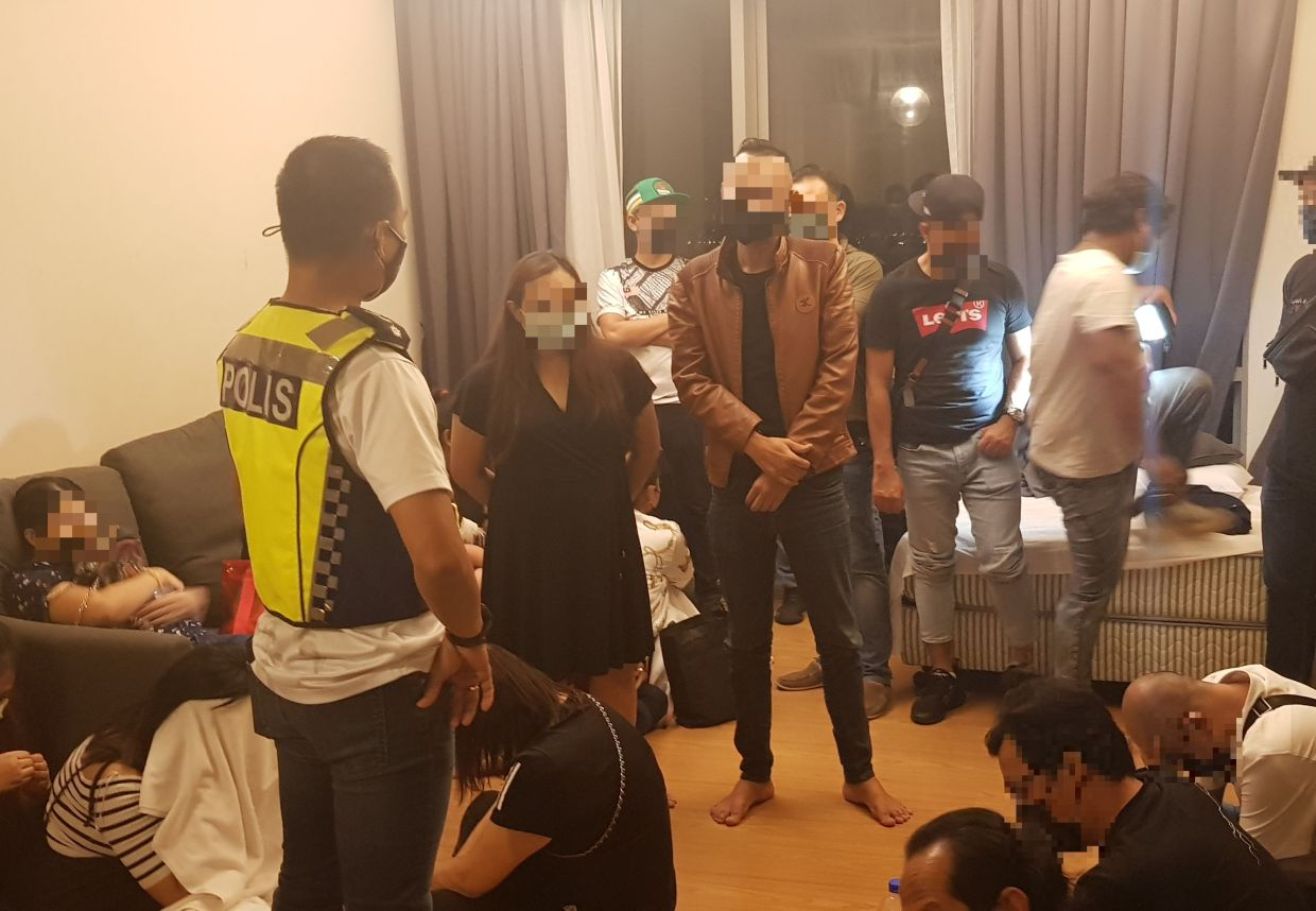 Police arrest people at a birthday party in KL
