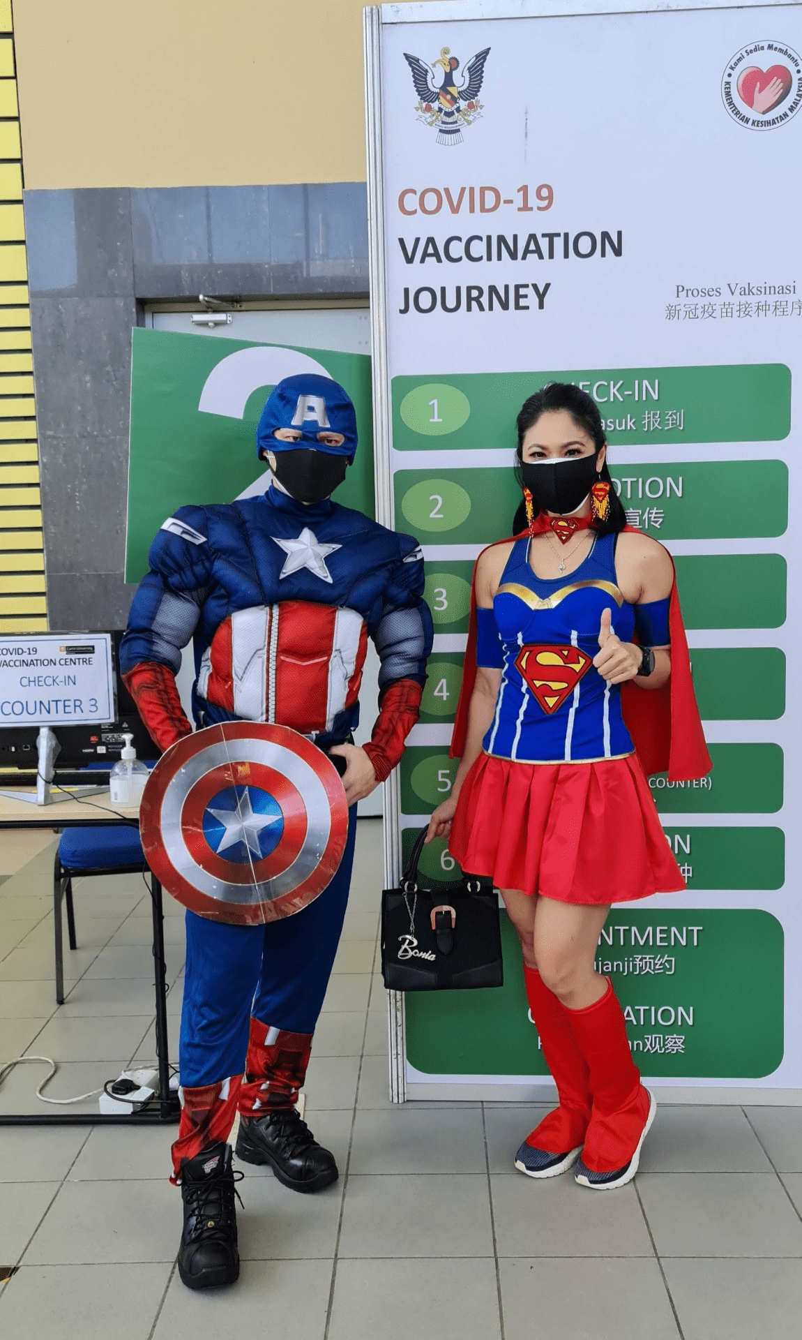 Malaysians wear costumes to vaccination - Captain America