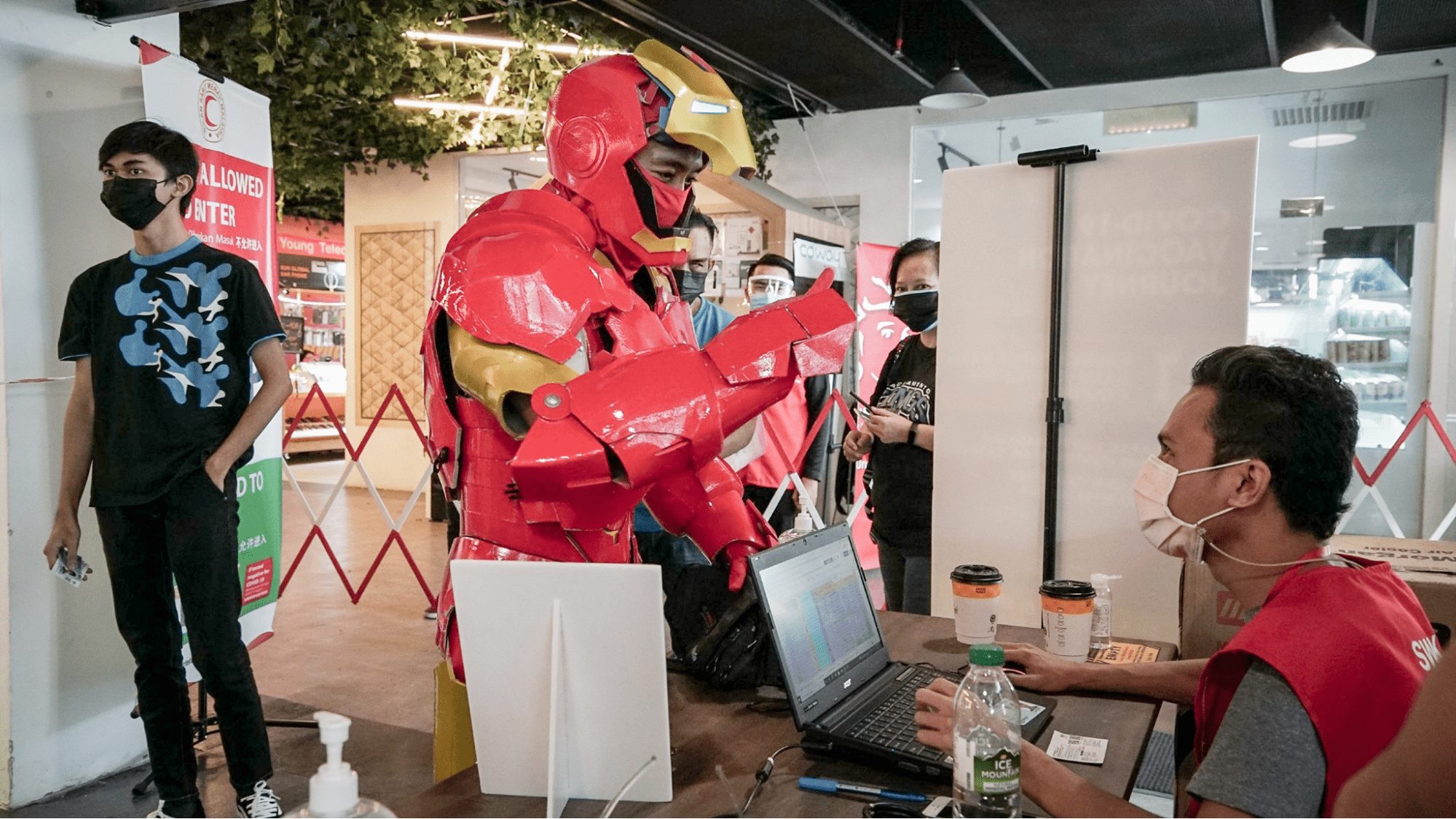 Malaysians wear costumes to vaccination - Iron Man