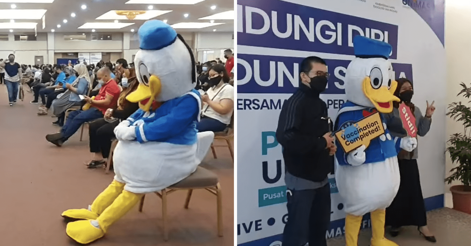 Malaysians wear costumes to vaccination - Donald Duck