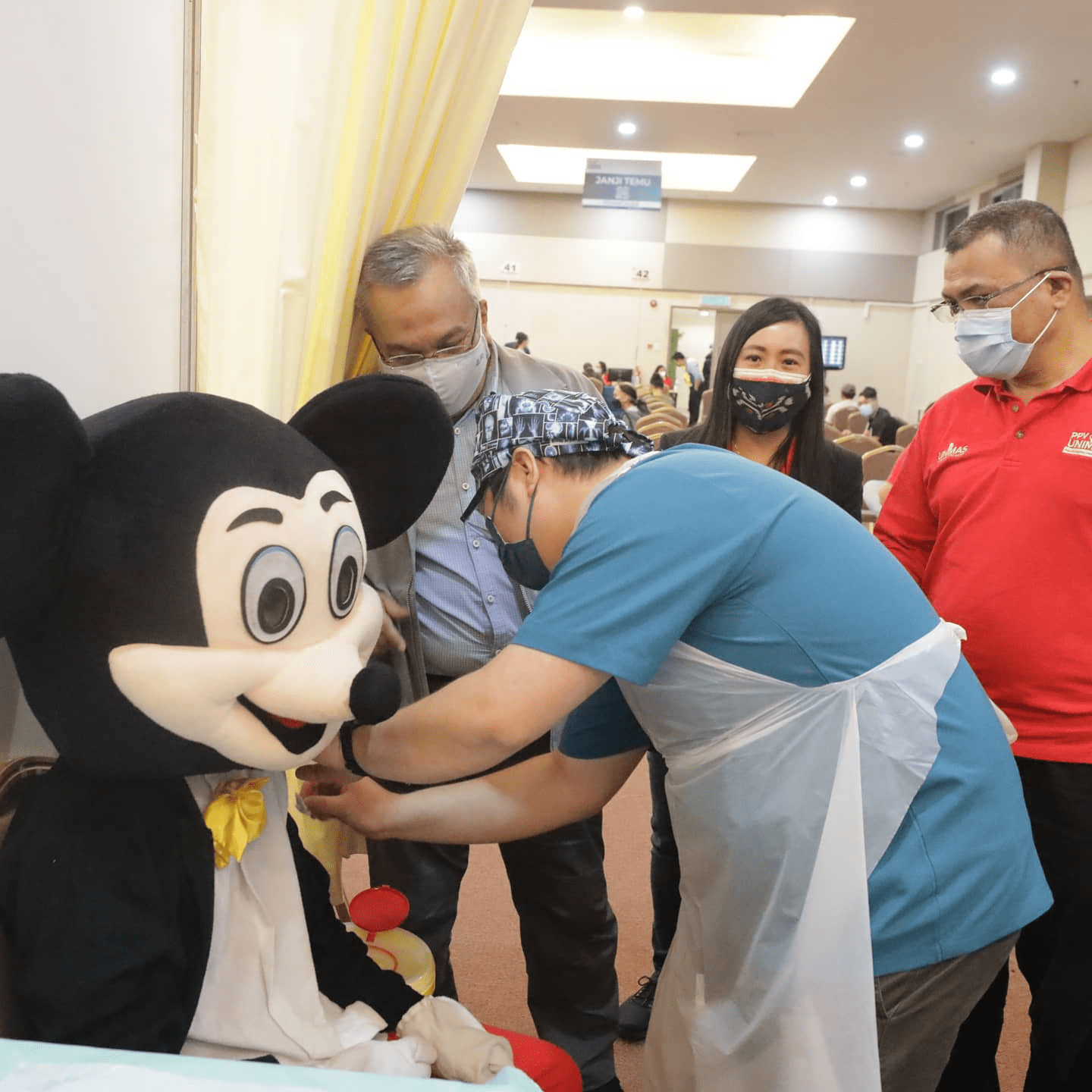 Malaysians wear costumes to vaccination - Mickey Mouse