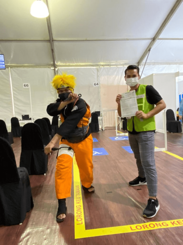 Malaysians wear costumes to vaccination - Naruto