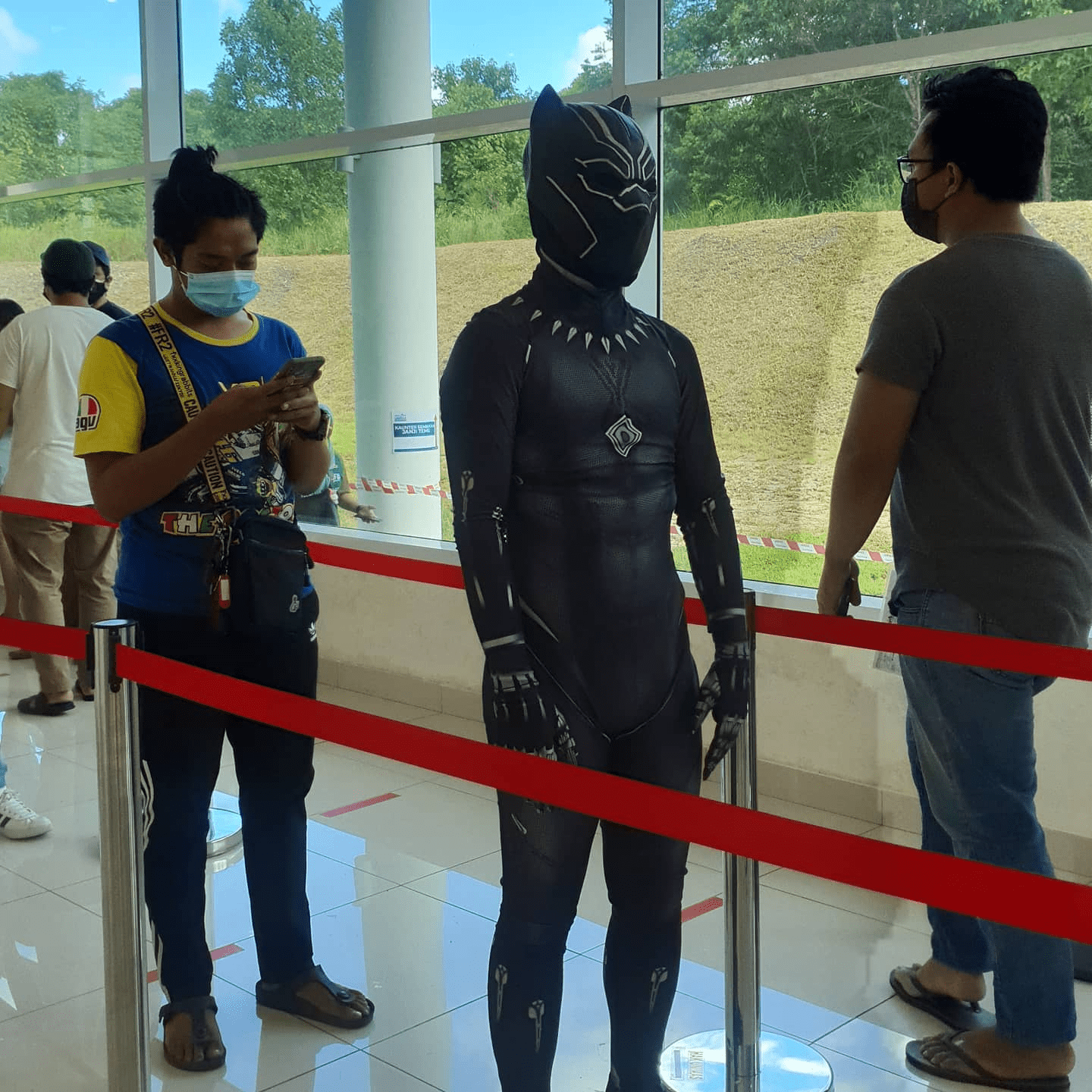 Malaysians wear costumes to vaccination - Black Panther