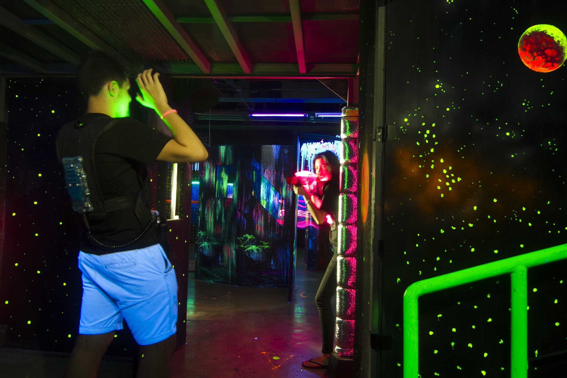 two people playing an indoor laser tag game