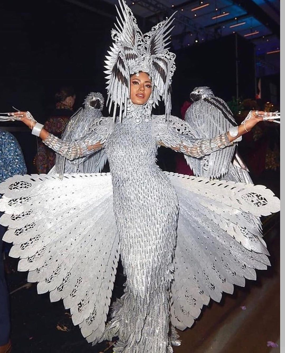 woman in silver costume