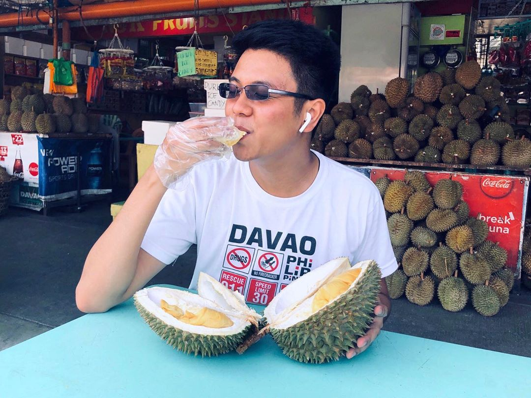 guy eating durians in davao