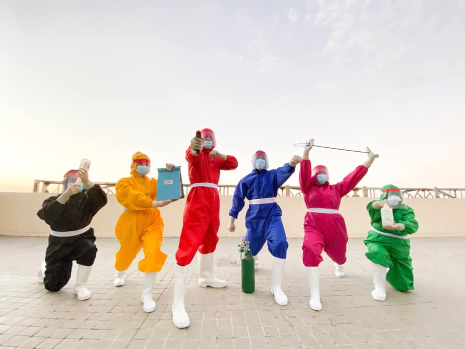 health workers in colorful hazmat suits
