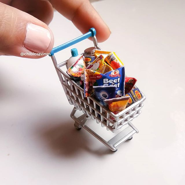 mini shopping cart filled with groceries