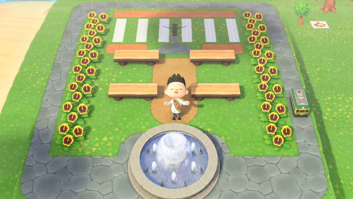Animal Crossing replication of the UP Oval, with a UP student in graduation outfit