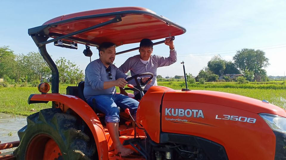 men on a tractor in pulilan