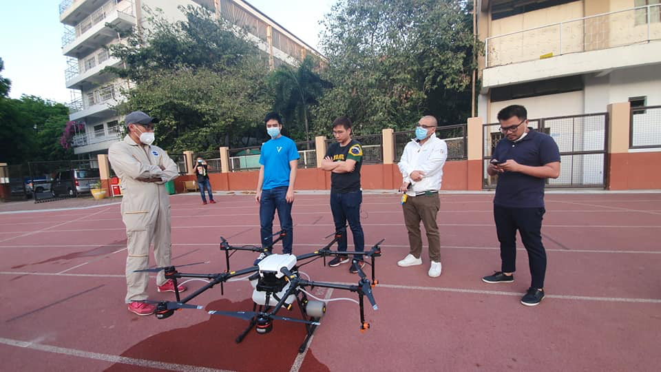 men testing a disinfectant drone