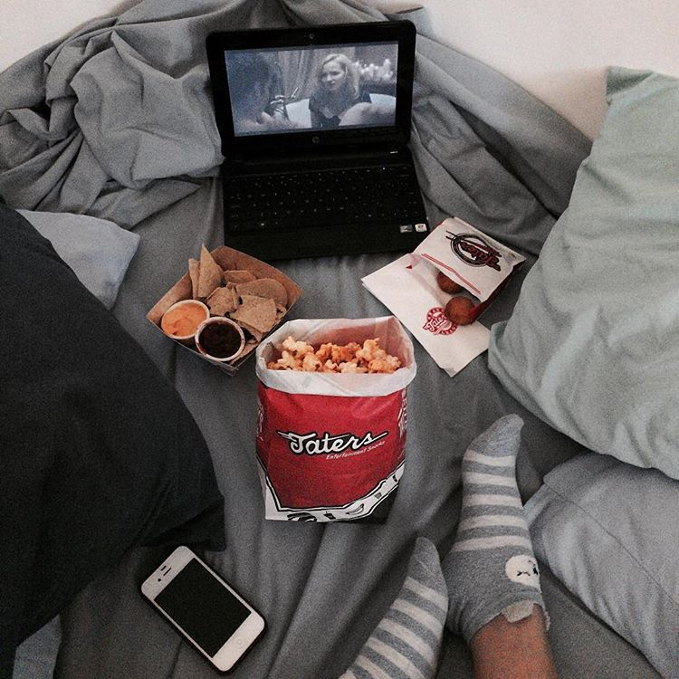 laptop and movie snacks in bed