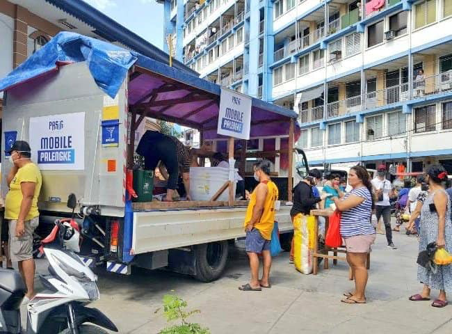 people buying from a mobile palengke