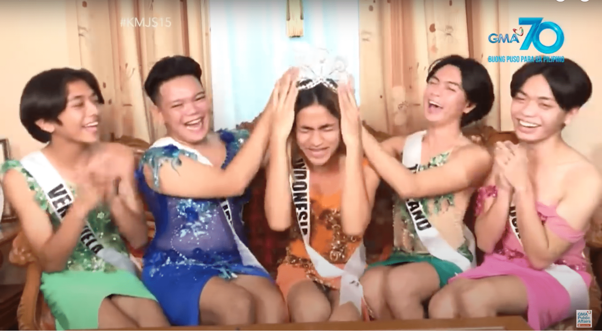 5 Filipinos with middle receiving a crown