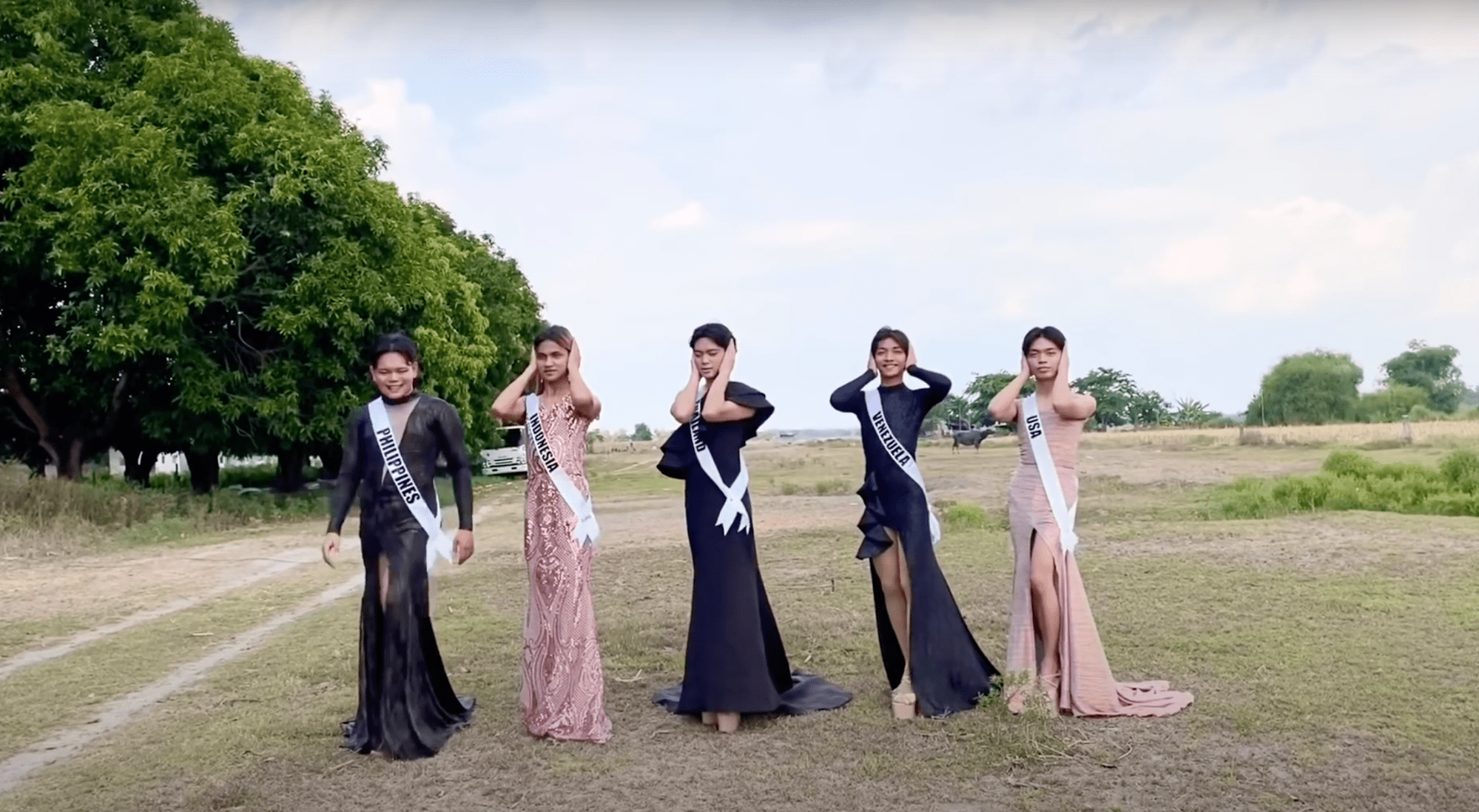 5 Filipinos in evening gowns, 4 covering their ears
