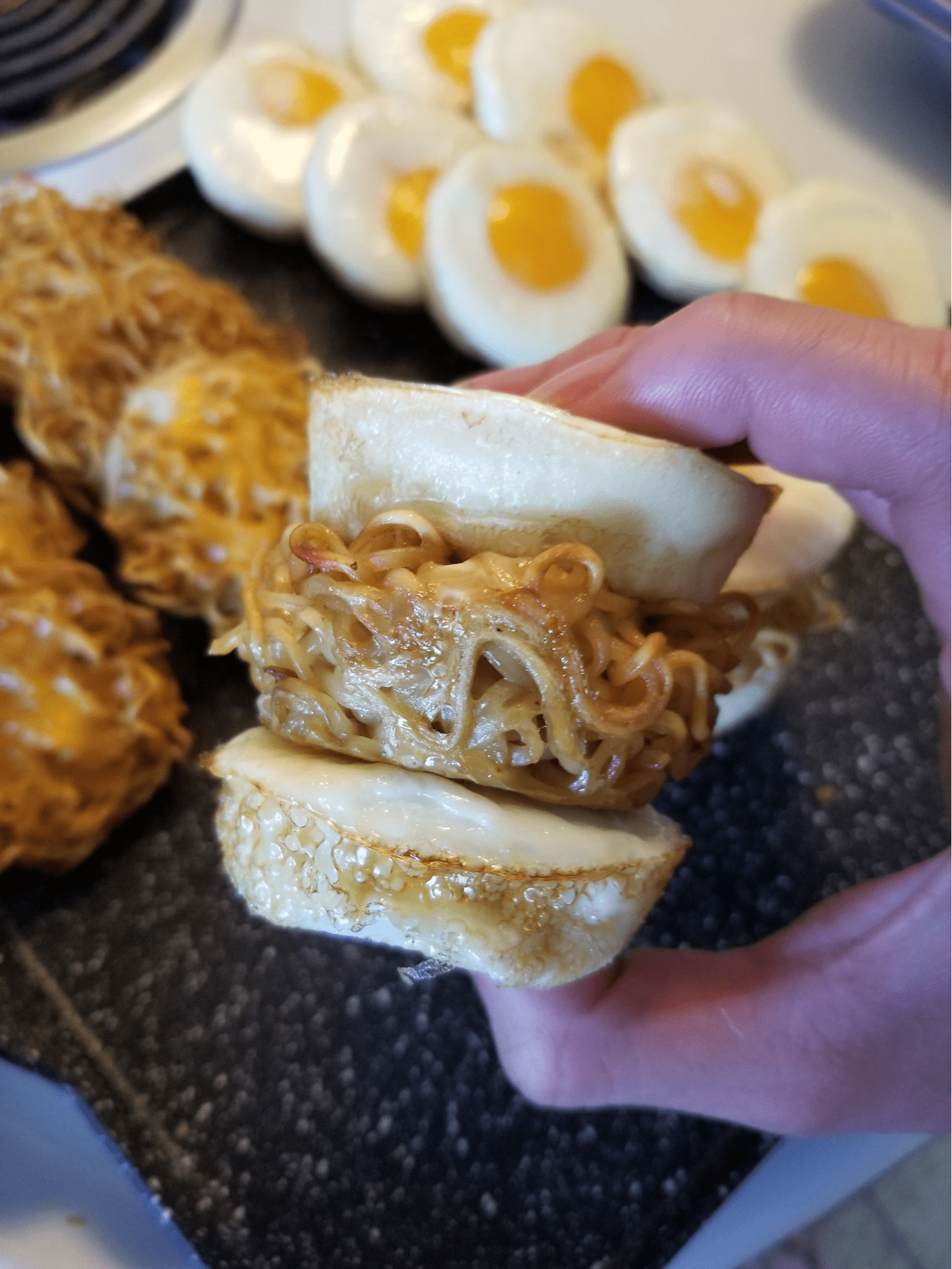 baked noodle cup sandwiched in two eggs