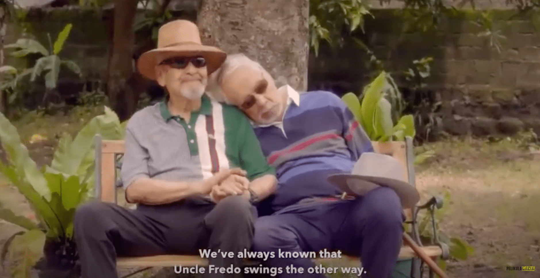 two old men leaning against each other
