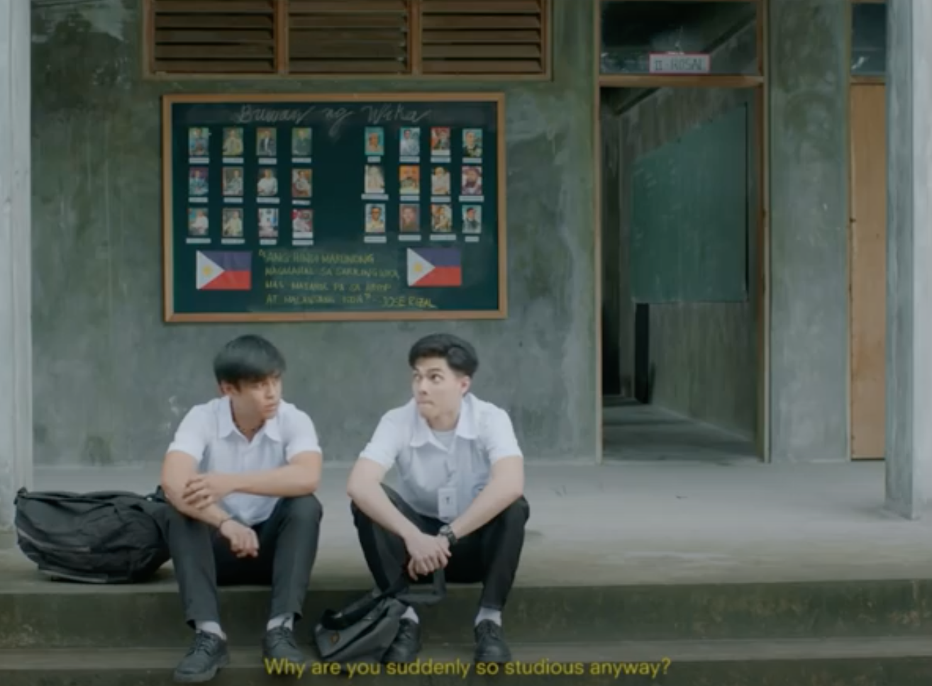 two boys sitting on the floor and talking