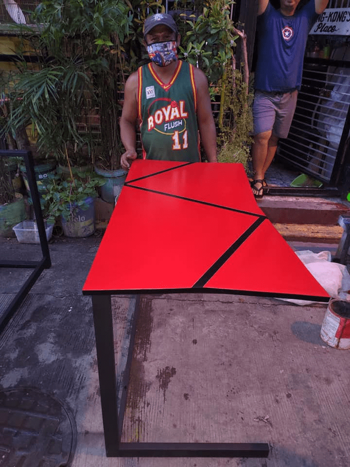 custom tables by jeepney drivers - man with red table