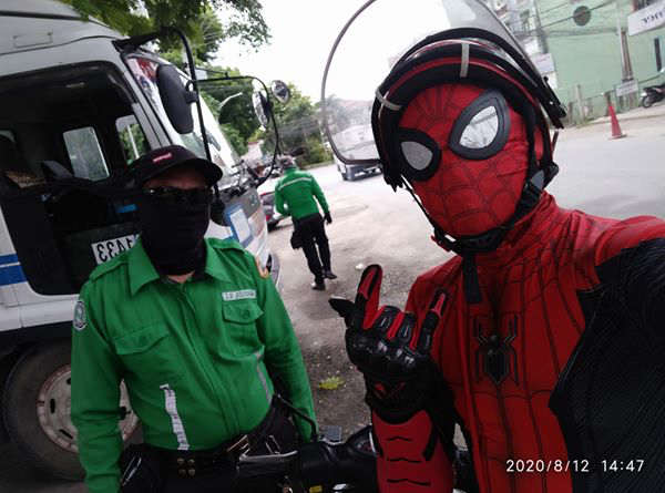 spiderman delivery man - spiderman with traffic enforcer