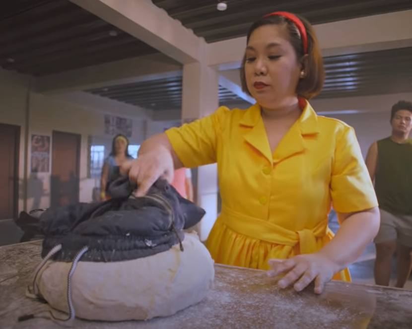 Julie's Bakeshop ad - Tita Julie preparing to roll the man-turned-dough into pandesal