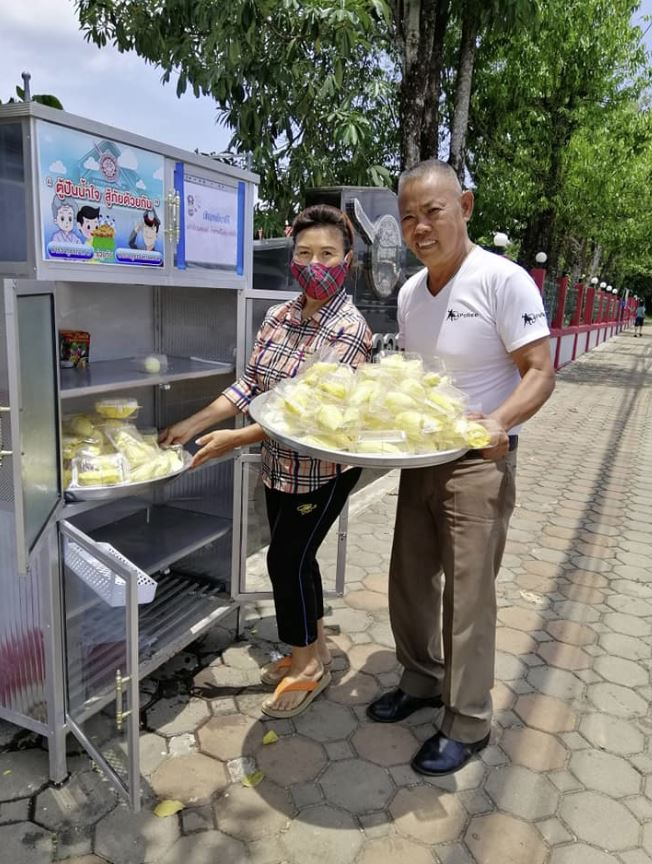 Thai lady give away durian at local sharing pantry