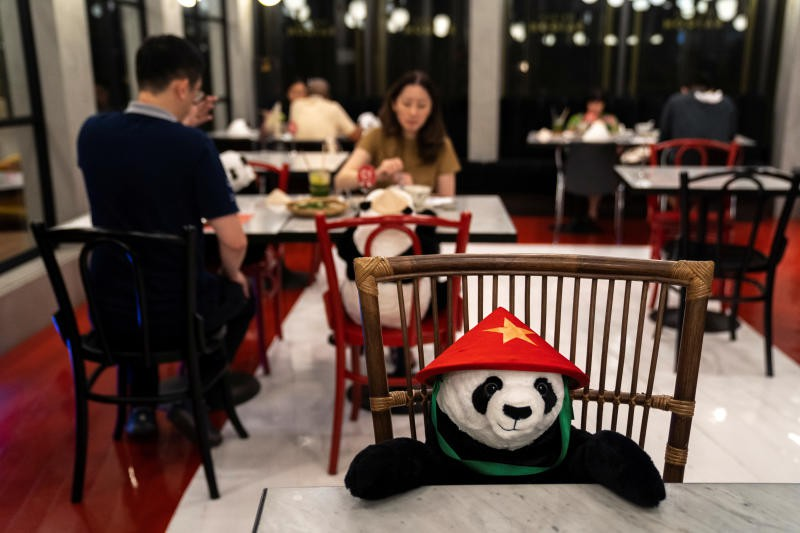 Bangkok Restaurant Offers Toy Panda Companions For Customers