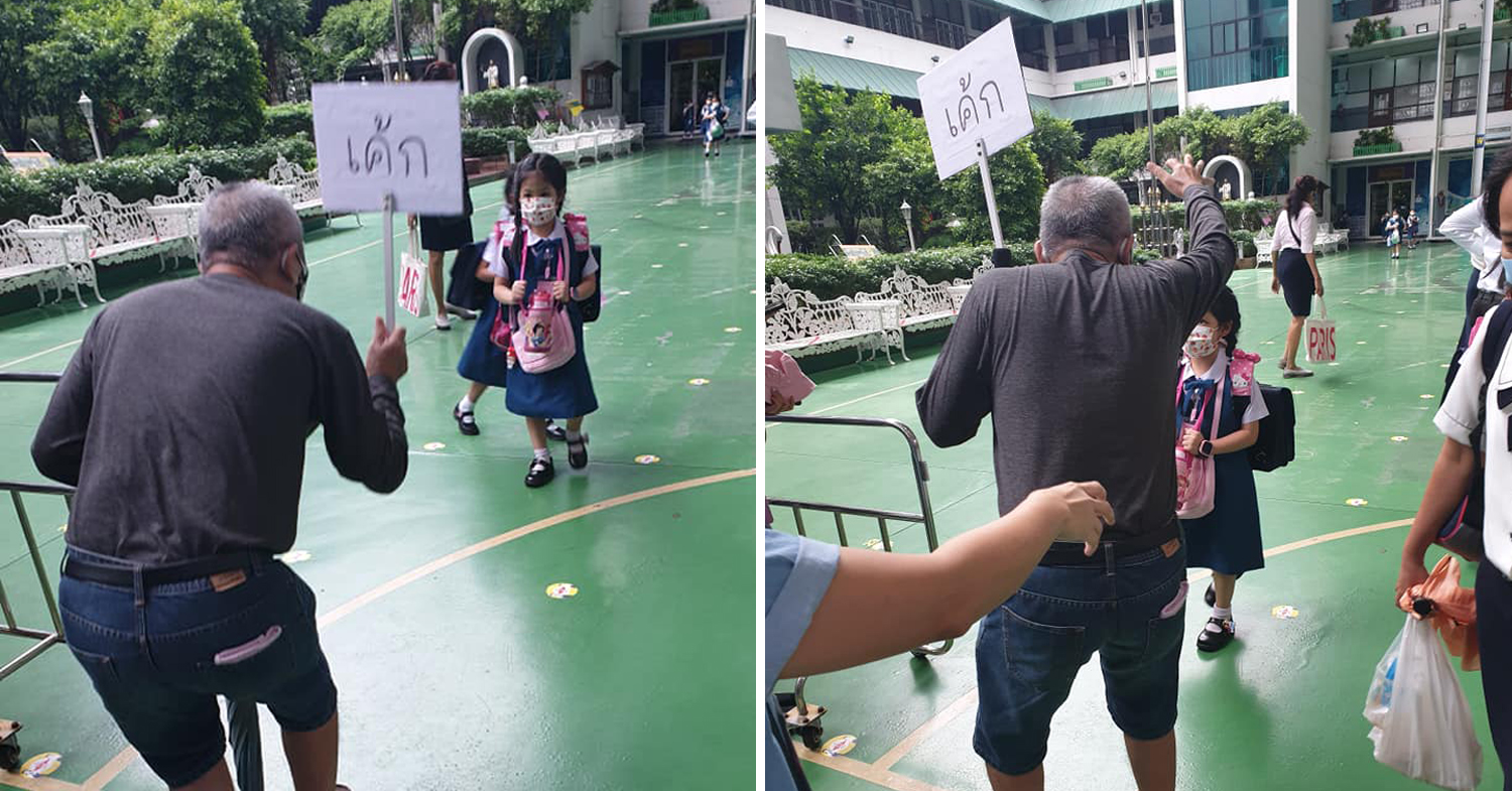 Thai grandpa makes a sign to pick up the right grandkid