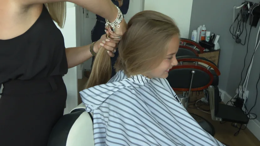 Donates hair to cancer patients