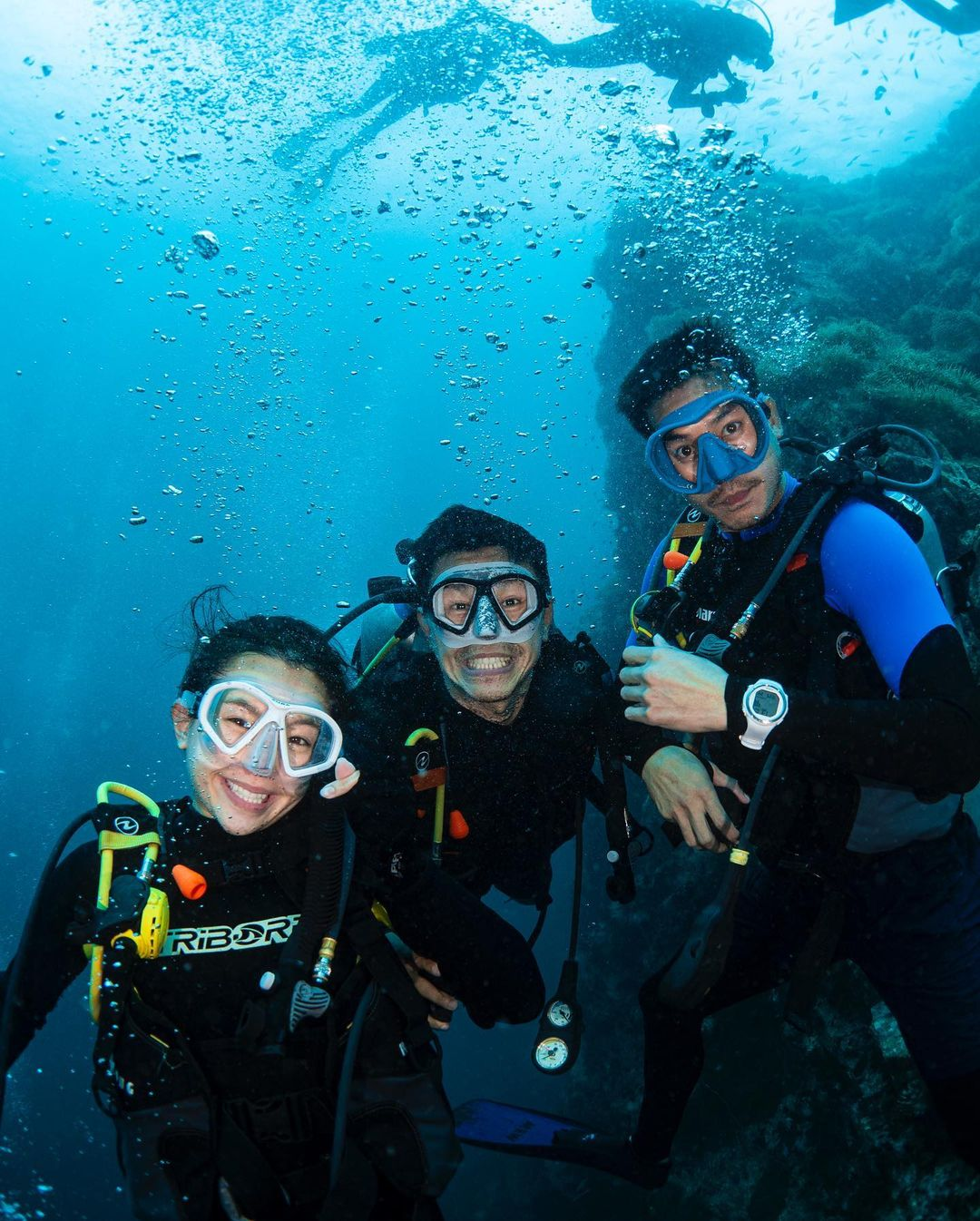 three divers underwater
