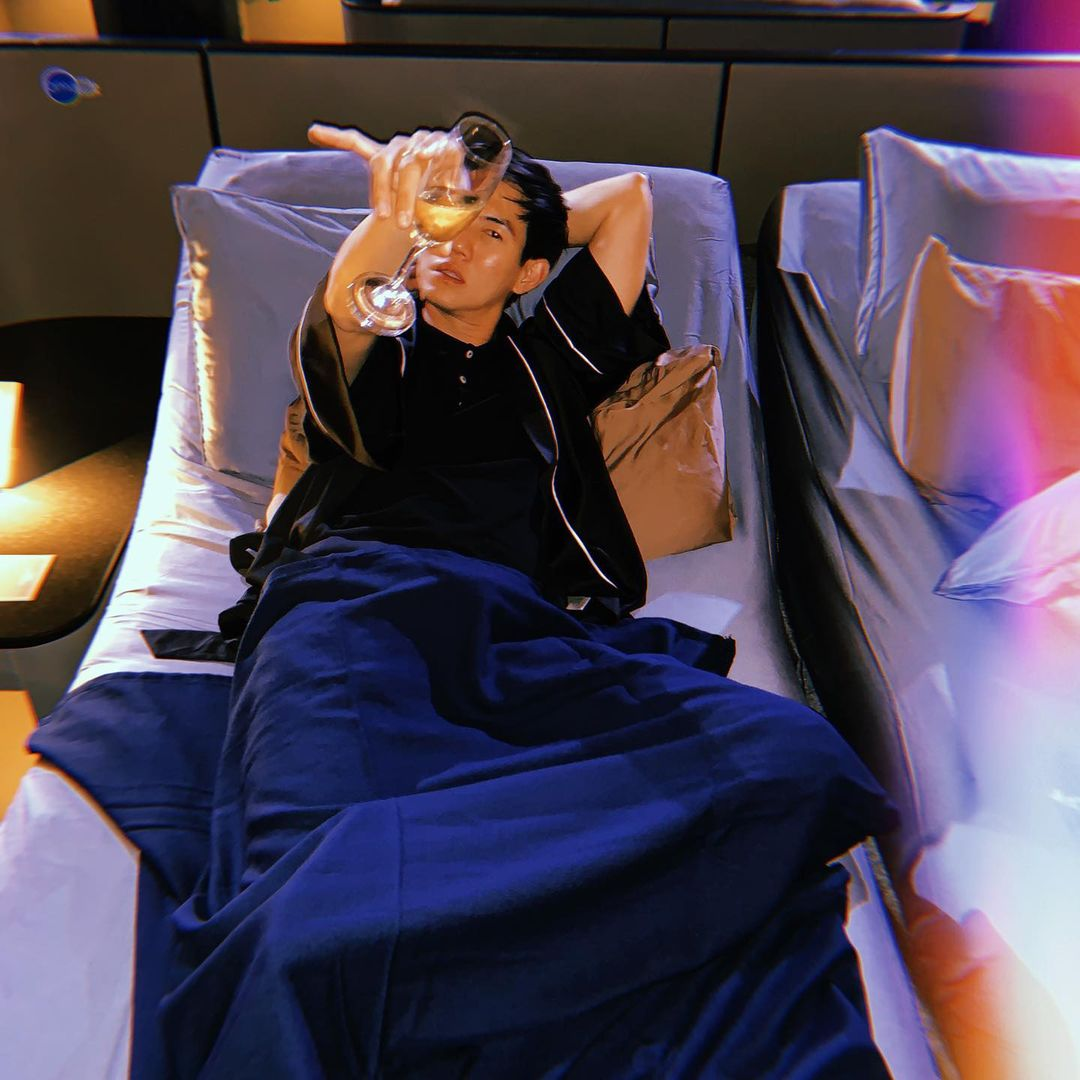 person with drink bed cinema