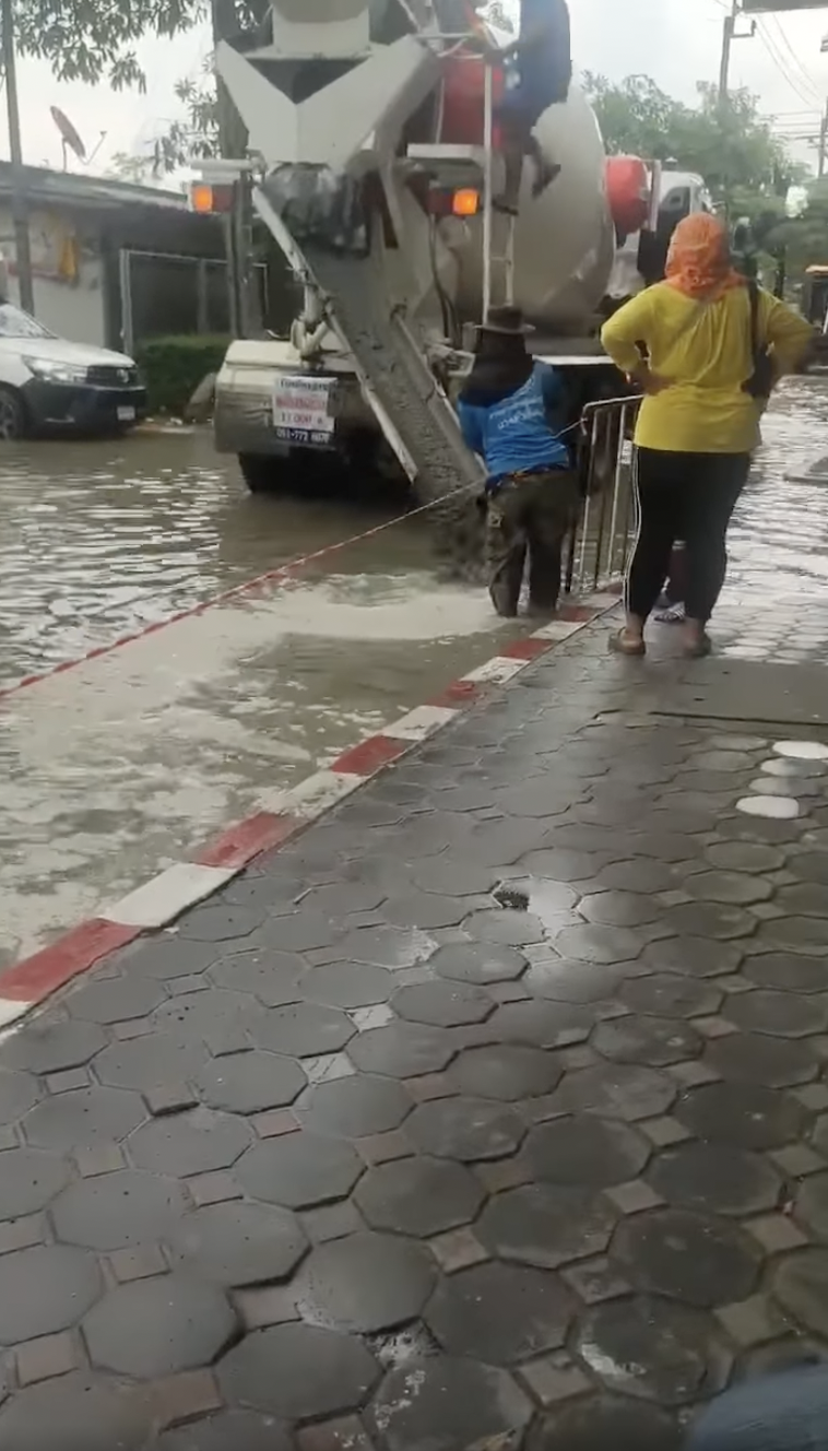 Thai Construction Crew Fixes Road In Heavy Flood, Netizens Question Its Effectiveness