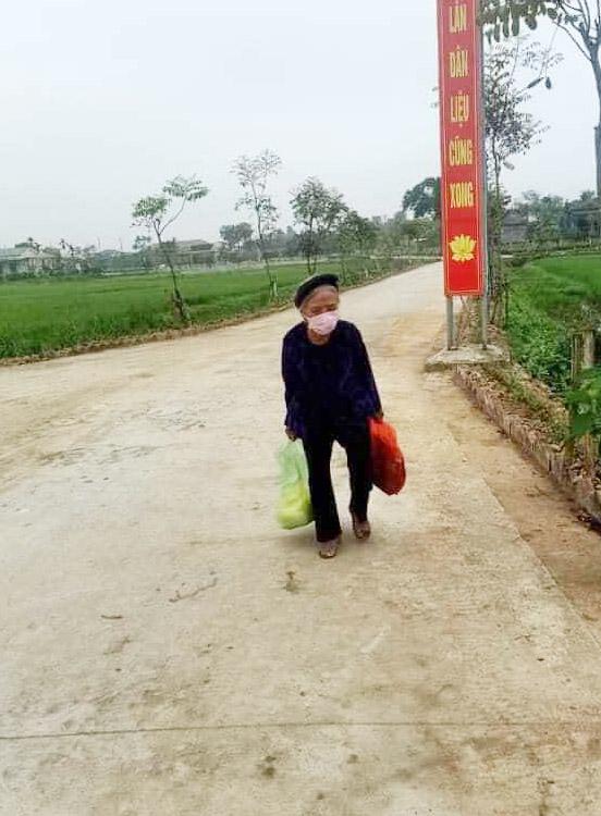 87 year old woman making donation walking