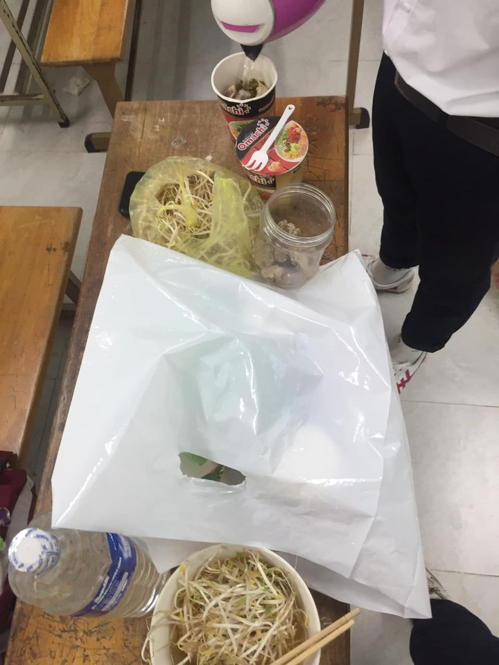 students cooking noodles