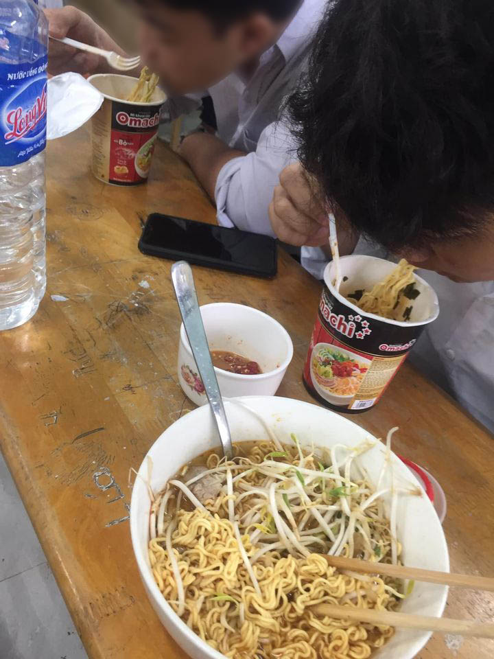 students eating noodles
