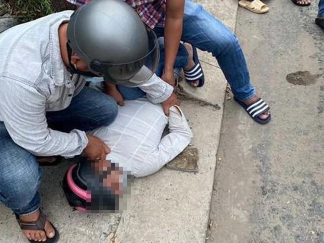 woman saigon robbers - apprehended robber