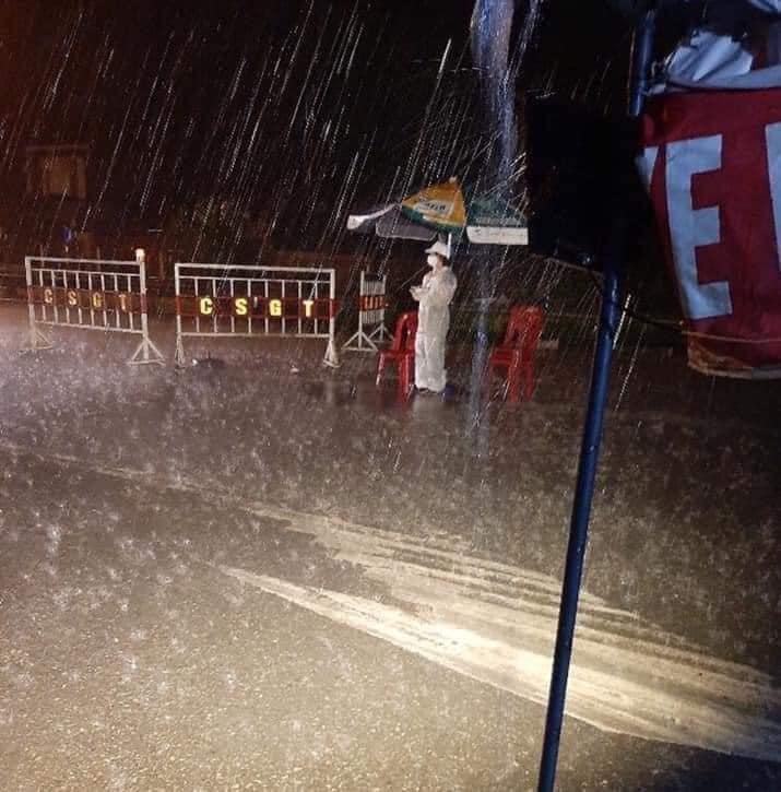 frontline worker standing in rain