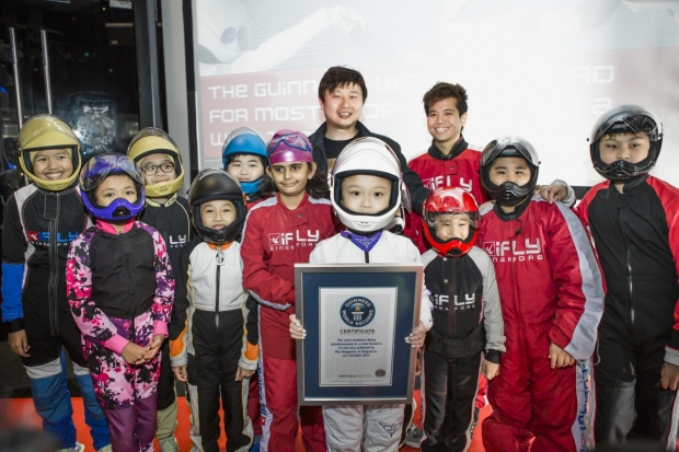 b2ap3_thumbnail_iFly-Singapore-founder-and-CEO-Lawrence-Koh-presents-the--Guinness-World-Record-certificate-for-most-flyers-in-a-wind-tunnel-to-the-13-man-team.jpg